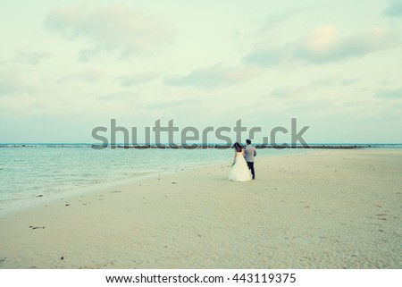 Happy groom and bride . thailand sea in the background. Wedding and honeymoon in tropics vintage concept  - stock photo