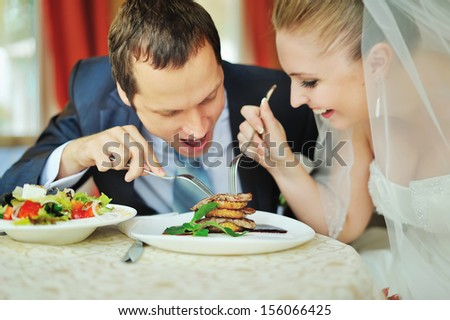 happy groom and bride  together in cafe having fun. Happy newlywed couple at wedding - stock photo