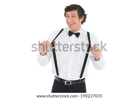 Happy groom stretching suspenders isolated over white background - stock photo