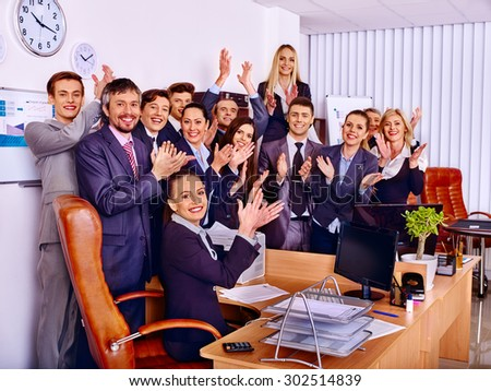 Happy group business people clap ones hands together in office. - stock photo