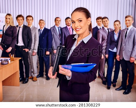 Happy group business people together  in office. Girl in foreground. - stock photo