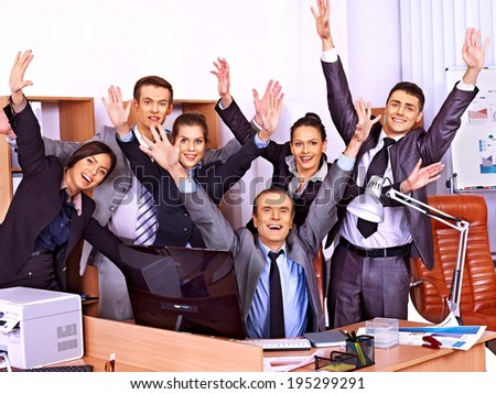 Happy group business people with hand up in office.