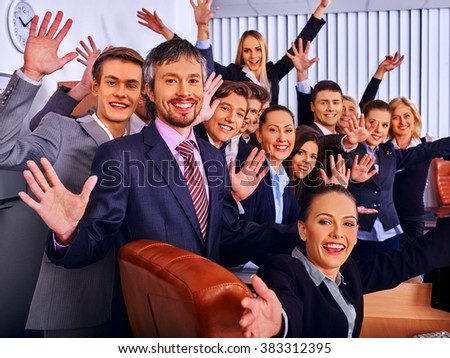 Happy group business people with hand up together in office. Jalousie background.