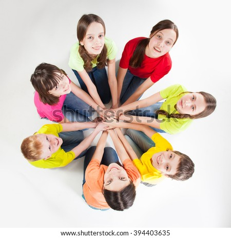 Happy group children isolated at white background. unity teen. Friendship boys and girls  - stock photo