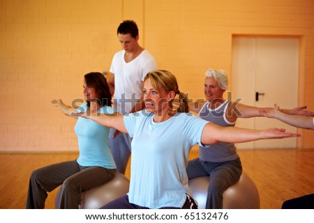Happy group in a gym doing back exercises - stock photo