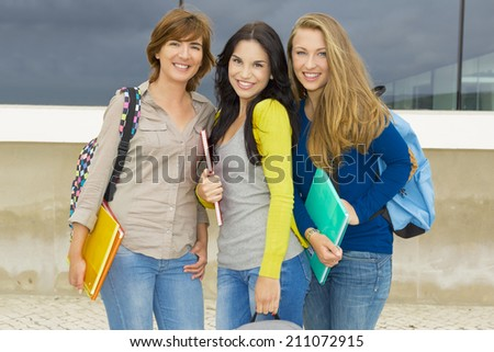 Happy group of beautiful female students in the school  - stock photo