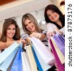 Happy group of beautiful shopping women smiling - stock photo