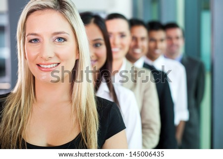 happy group of business people in a row - stock photo