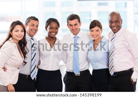 Happy group of business people together at the office  - stock photo