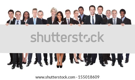 Happy Group Of Businesspeople Holding Placard Over White Background - stock photo