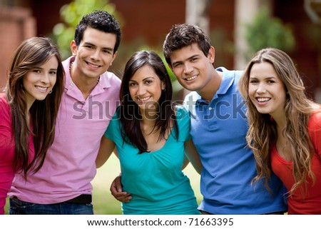 Happy group of casual friends smiling outdoors - stock photo