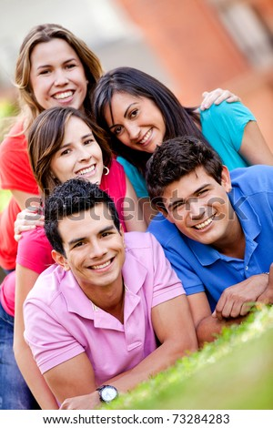 Happy group of casual people smiling outdoors - stock photo