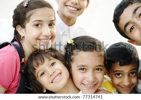 Happy group of children friends together outdoor, portrait