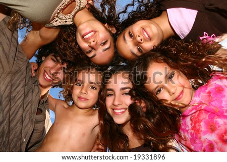 Happy Group of Children Looking Down and Smiling - stock photo