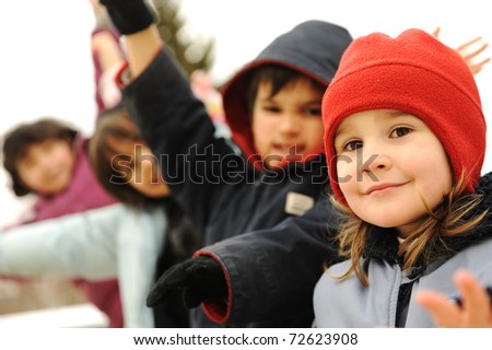 Happy group of children outdoor, winter clothes - stock photo