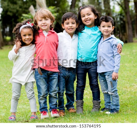 Happy group of children together at the park  - stock photo