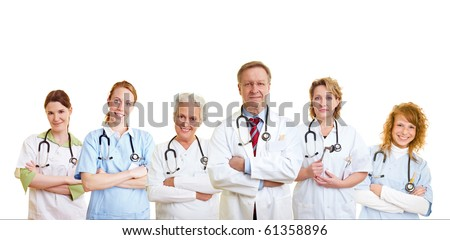 Happy group of doctors and other medical care people - stock photo