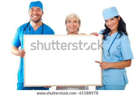 Happy group of doctors holding a lank placard and a doctor woman pointing to copy space banner isolated on white background - stock photo