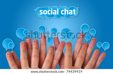 Happy group of finger faces with social chat sign and speech bubbles - stock photo