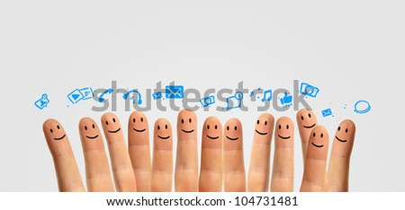 Happy group of finger smileys, concept of social network - stock photo