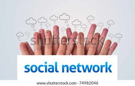 Happy group of finger smileys holding whiteboard with social network sign - stock photo
