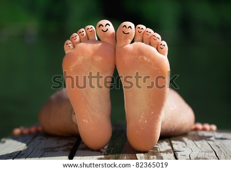 Happy group of finger smileys in nature 3 - stock photo