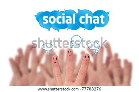 Happy group of finger smileys with social chat sign and speech bubbles - stock photo