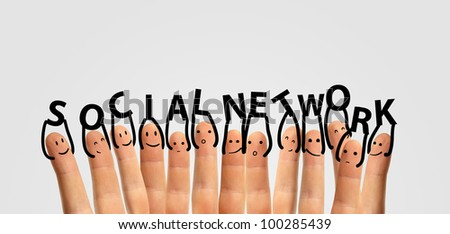 Happy group of finger smileys with social chat sign and speech bubbles, icons. Hands holding  letters. Fingers representing a social network. - stock photo