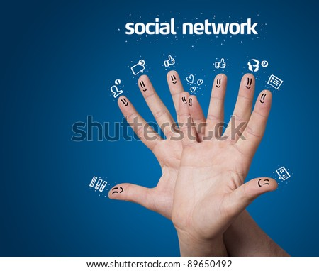 Happy group of finger smileys with social network sign and icons on blue background - stock photo