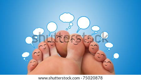 Happy group of finger smileys with speech bubbles - stock photo