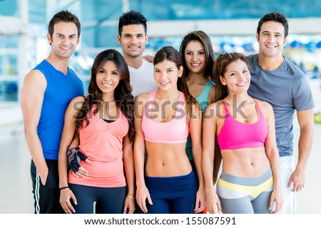Happy group of fit people at the gym  - stock photo