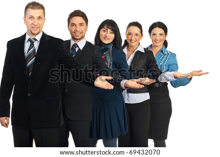 Happy group of five business people standing with open palms to copy space and welcoming isolated on white background - stock photo