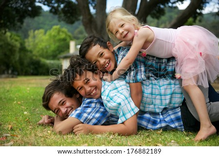 Happy group of four young children. - stock photo