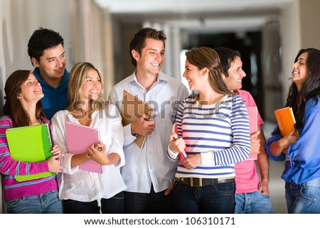Happy group of friends at the university talking and smiling - stock photo