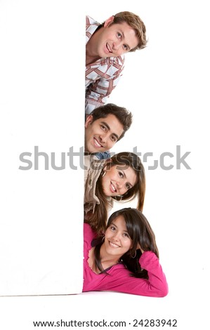 happy group of friends holding a banner ad on the floor - stock photo