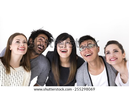 Happy group of friends looking up above them. Mixed race group. Isolated on a white background. - stock photo