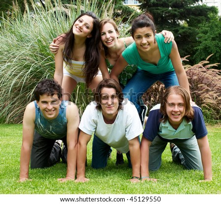 happy group of friends outdoors in a park - stock photo