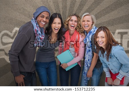 Happy group of friends posing together on grey background