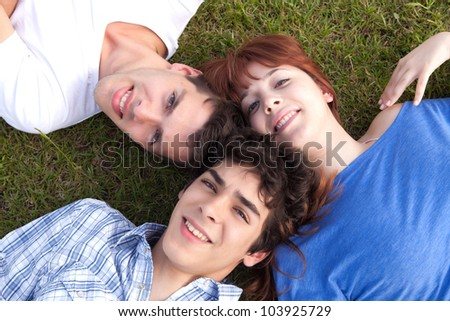 Happy group of friends relaxing at the park - stock photo