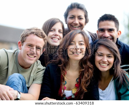 Happy group of friends smiling and hugging  outdoors - stock photo