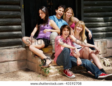 happy group of friends smiling outdoors