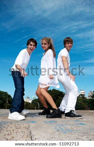 happy group of friends smiling outdoors in a park - stock photo