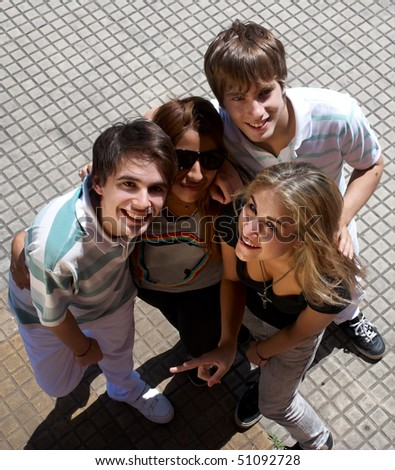 happy group of friends smiling outdoors in a street - stock photo