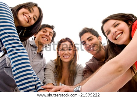 happy group of friends smiling with their hands together isolated over a white background - stock photo
