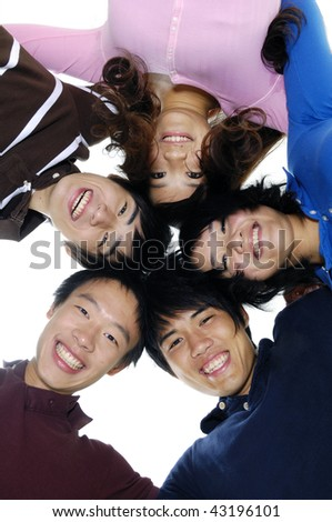happy group of friends smiling with their heads together