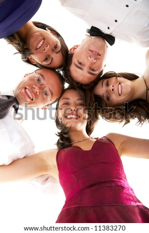 happy group of friends smiling with their heads together ready to party isolated over a white background - stock photo