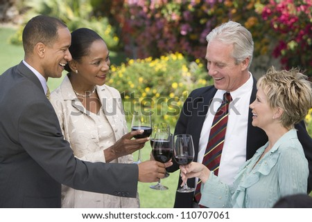 Happy group of friends toasting wine together - stock photo