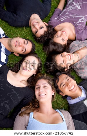 happy group of friends together on the floor outdoors