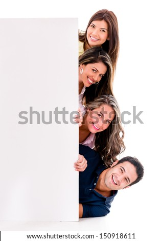 Happy group of friends with a banner - isolated over white background  - stock photo