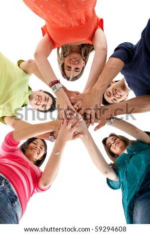 Happy group of friends with their hands together in the middle - isolated - stock photo
